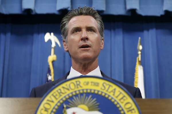 This July 23, 2019 photo shows California Gov. Gavin Newsom during a news conference in Sacramento, Calif. Newsom signed a law Tuesday, July 30, requiring presidential candidates to release their tax returns to appear on the state's primary ballot, a move aimed squarely at Republican President Donald Trump. (AP Photo/Rich Pedroncelli)