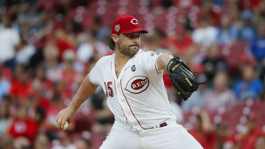 Cincinnati Reds starting pitcher Tanner Roark throws in the second inning of a baseball game against the Pittsburgh Pirates, Tuesday, July 30, 2019, in Cincinnati. (AP Photo/John Minchillo) Photo: John Minchillo, Associated Press