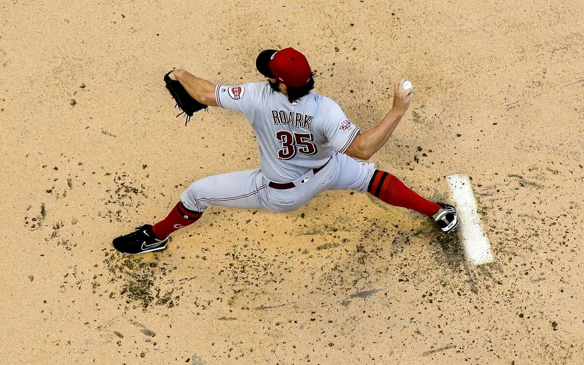 Cincinnati Reds starting pitcher Tanner Roark throws during the first inning of a baseball game against the Milwaukee Brewers Tuesday, July 23, 2019, in Milwaukee. (AP Photo/Morry Gash)
