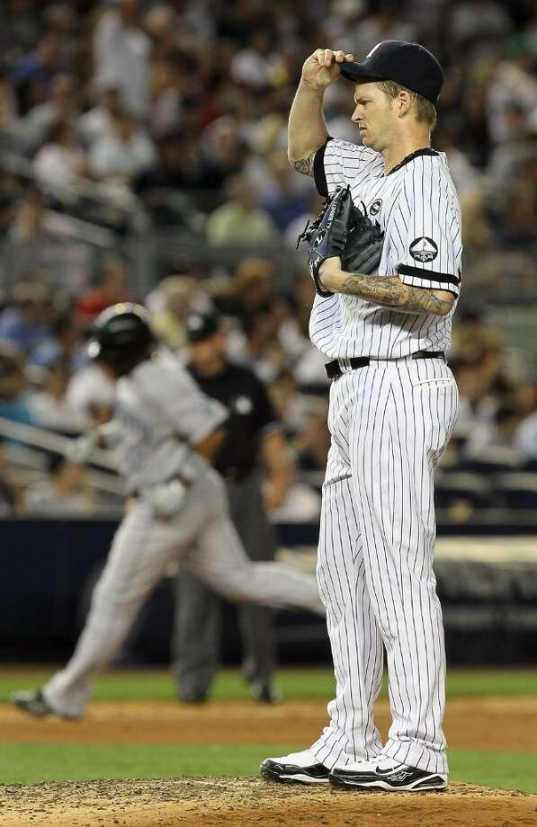 NEW YORK - AUGUST 02:  A.J. Burnett #34 of the New York Yankees reacts during the fifth inning after surrendering a two run home run to Edwin Encarnacion #12 of the Toronto Blue Jays on August 2, 2010 at Yankee Stadium in the Bronx borough of New York City.  (Photo by Jim McIsaac/Getty Images) *** Local Caption *** A.J. Burnett;Edwin Encarnacion Photo: Jim McIsaac, Getty Images / 2010 Getty Images