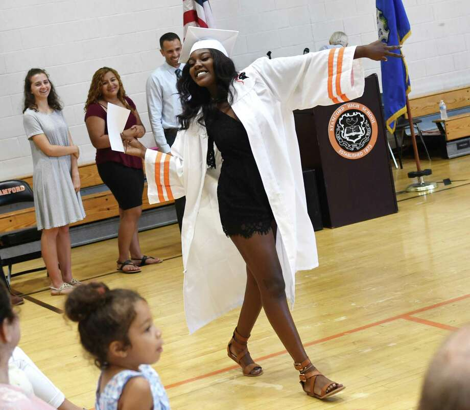 Stamford High School graduate Carlisa West struts after receiving her diploma at the Summer High School Graduation Ceremony at Stamford High School in Stamford, Conn. Wednesday, July 31, 2019. 27 summer graduates from Stamford and Westhill High Schools received their diplomas in a spirited ceremony featuring remarks from Stamford Superintendent of Schools Dr. Tamu Lucero, Summer School Head Teacher Joseph Cozza and Counselor Robert Augustyn. Photo: Tyler Sizemore / Hearst Connecticut Media / Greenwich Time