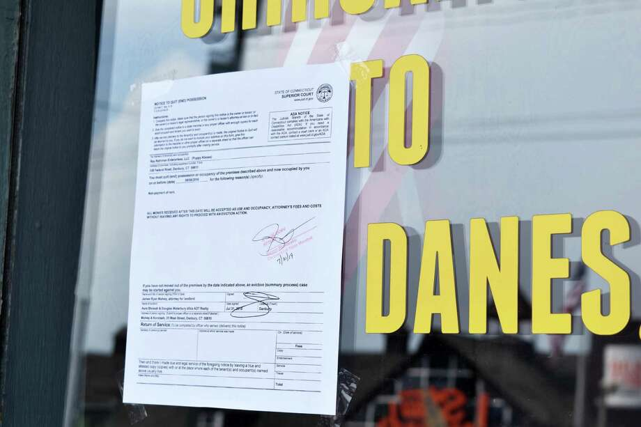 An eviction noticed posted outside Puppy Kisses, 128 Federal Road, on Wednesday, July 31, 2019. Photo: Kendra Baker / Hearst Connecticut Media