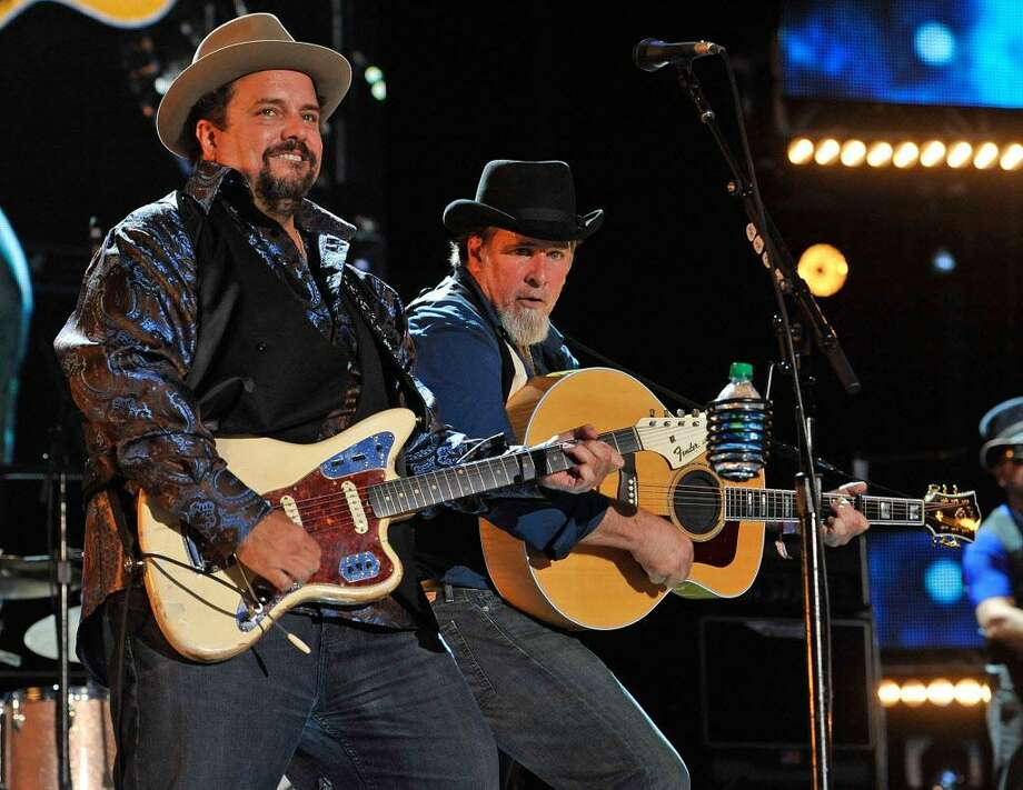 Raul Malo and Robert Reynolds of The Mavericks performs at LP Field during the 2012 CMA Music Festival on June 10, 2012 in Nashville, Tennessee.  (Photo by Frederick Breedon IV/Getty Images) Photo: Frederick Breedon IV / Frederick Breedon IV/Getty Images / 2012 Frederick Breedon IV