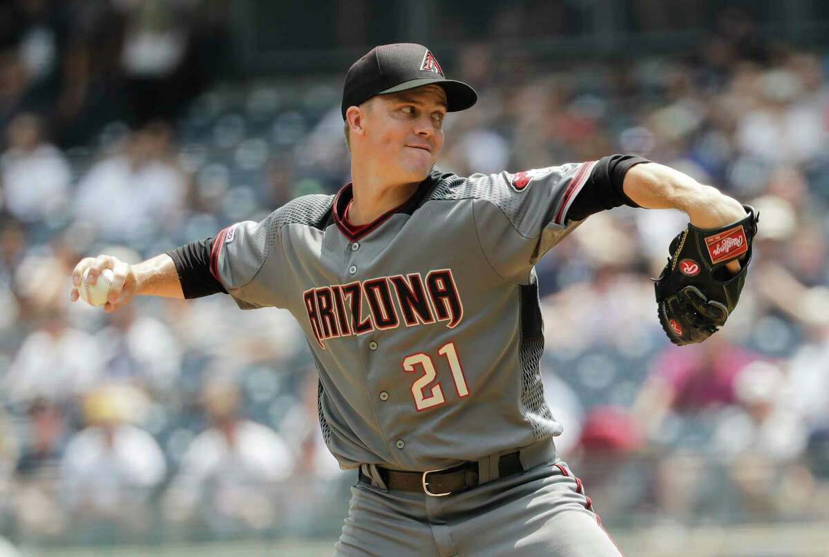 Zack Greinke delivers a pitch during the first inning against the Yankees. He was traded to the Astros shortly after the game.