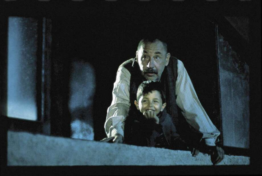 "Alfredo (Philippe Noiret) shares his love of movies with young Toto (Salvatore Cascio) in the director's cut of ""Cinema Paradiso: The New Version"" Photo: MIRAMAX PICTURES"