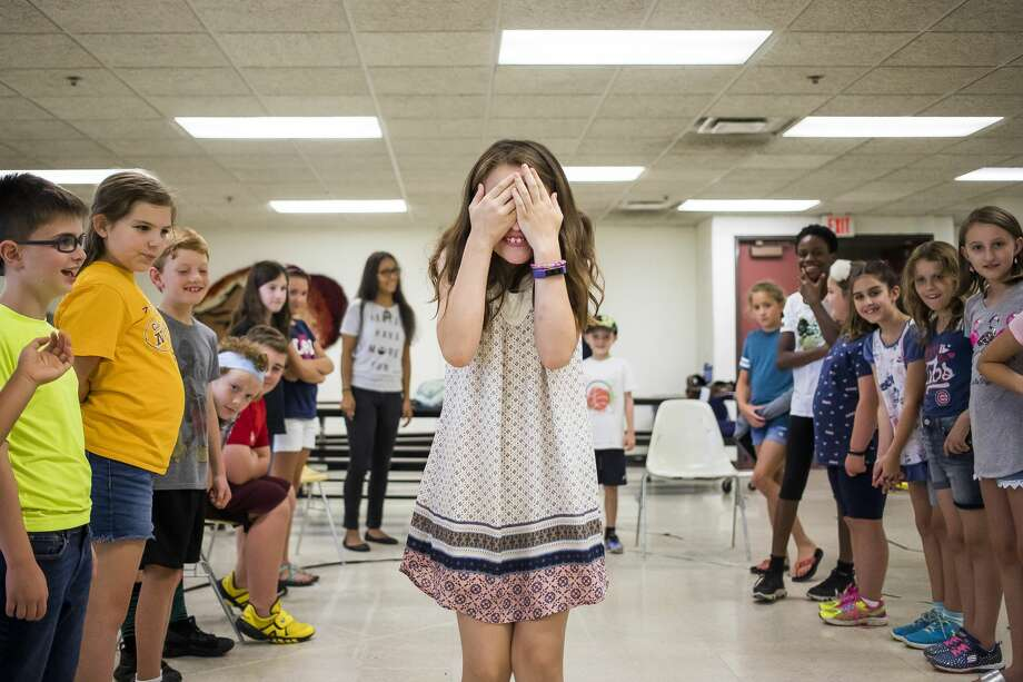 Lorelai Boldt covers her eyes while walking between two lines of classmates during the second session of a weeklong improv camp on Tuesday, July 30, 2019 at Midland Center for the Arts. (Katy Kildee/kkildee@mdn.net) Photo: (Katy Kildee/kkildee@mdn.net)