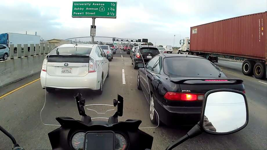 Lane-splitting through gridlock on Interstate-80 in Berkeley. There isn't a lot of room between these two cars (and my luggage) so I'm only doing 15 here. Photo: Chris Preovolos