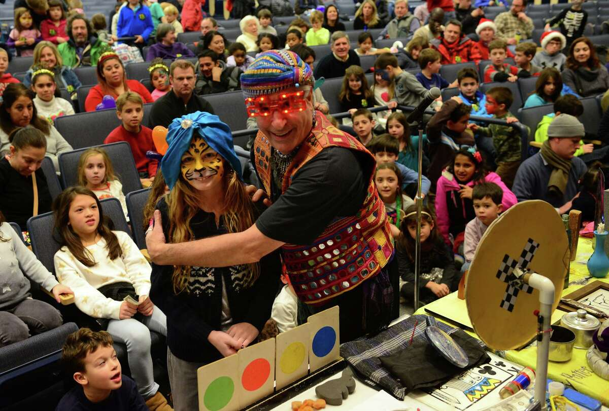 The Magic Genie, shown performing at Saugatuck Elementary School, comes to Wilton Library on Aug. 8.
