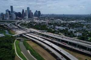 Interstate 45, left, and Interstate 10 diverge as they cross White Oak Bayou north of downtown, seen on Friday, July 5, 2019, in Houston.