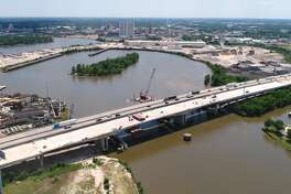 At about 97 percent complete, the Purple Heart Bridge is expected to be open to traffic by Summer's end. While the road is finalized, the Texas Department of Transportation still needs to smooth the surface, construct railing and other tasks before all lanes open. Drone footage with a bridge engineer's commentary can be seen at beaumontenterprise.com. Photo taken Wednesday, May 09, 2018 Guiseppe Barranco/The Enterprise