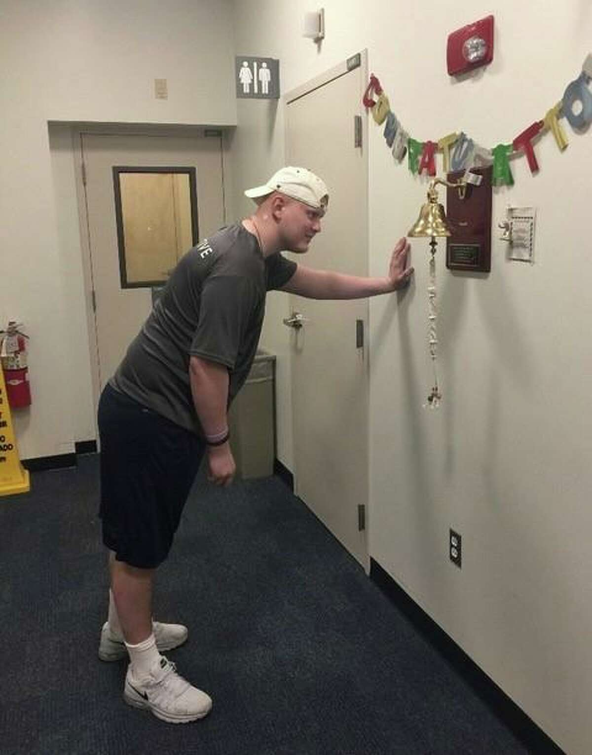 """Alex Bamford, who was diagnosed with a rare pediatric cancer at age 16, at Massachusetts General Hospital, where he endured two months of chemotherapy and proton radiation treatment. When a patient finishes treatment, they are allowed to """"ring the bell,"""" according to his father, Mark Bamford."""