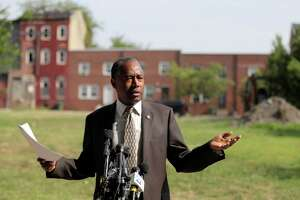 Housing and Urban Development Secretary Ben Carson speaks during a news conference after touring the Hollins House, a high rise building housing seniors and persons with disabilities, during a trip to Baltimore, Wednesday, July 31, 2019. Carson highlighted the Hollins House, which has 130 one-bedroom units, as an opportunity zone where encourage investment and development in distressed communities.