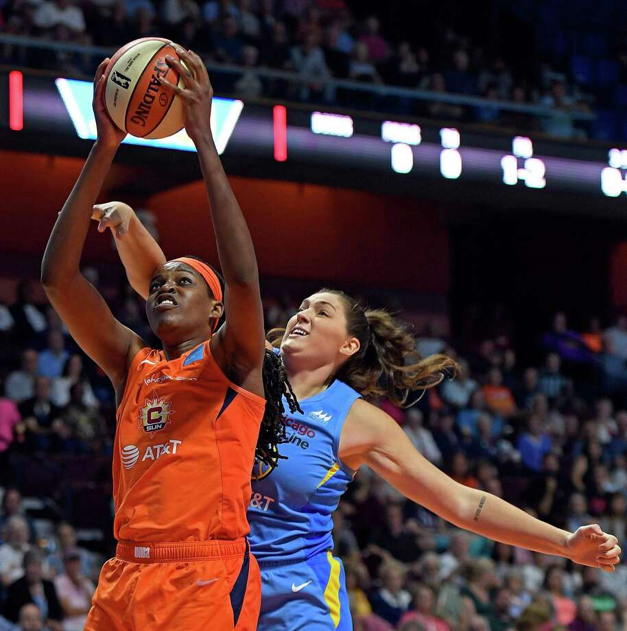 Connecticut Sun center Jonquel Jones scores around the defense of Chicago Sky center Stefanie Dolson, a former UConn player, at Mohegan Sun Arena Tuesday. Photo: Sean D. Elliot / The Day Via AP / 2019 The Day Publishing Company