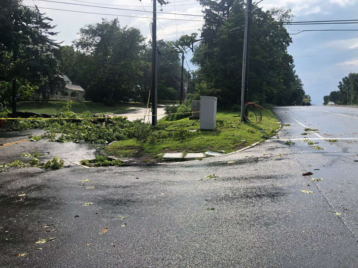 A portion of the damage done when a tree fell on Albany Avenue in West Hartford on Wednesday, Aug. 1, 2019.