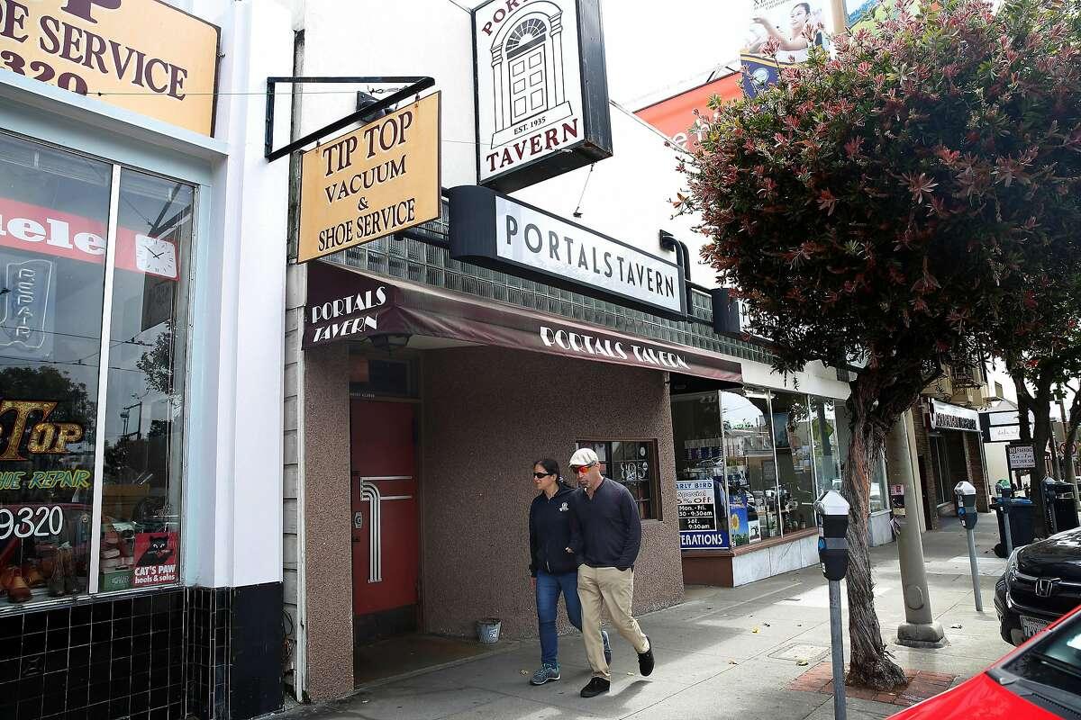 Pedestrians walk past Portals Tavern on Wednesday, July 31, 2019 in San Francisco, Calif.