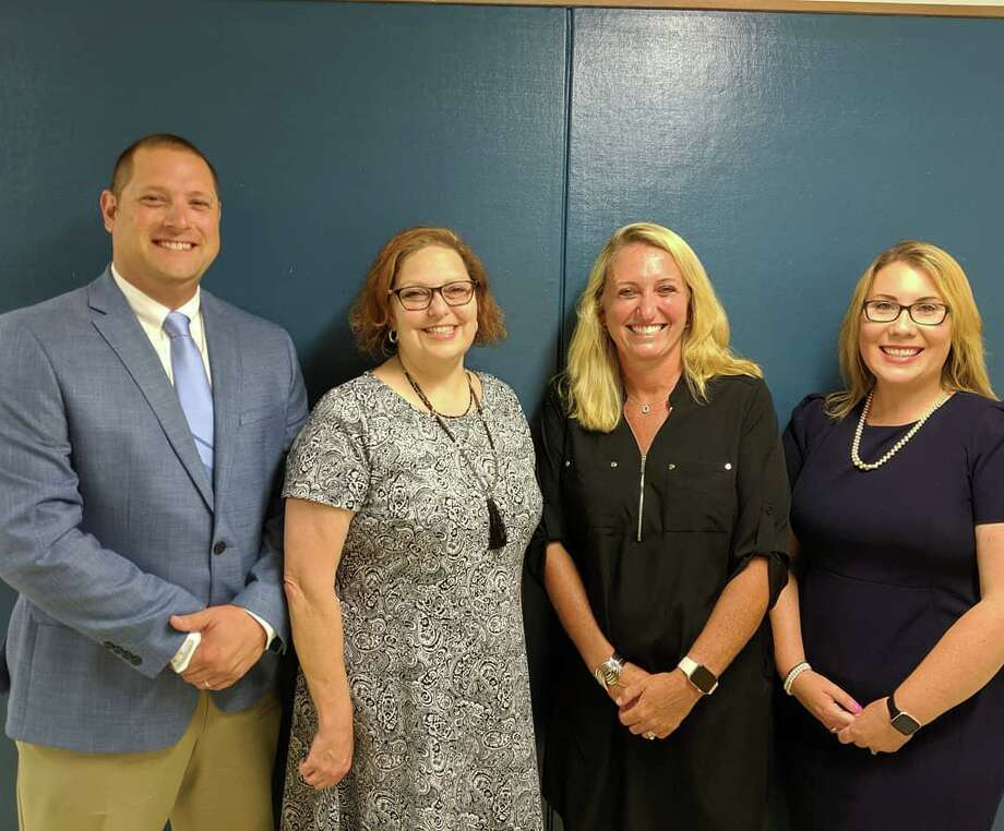 The Board of Education named Robert Ayer, assistant principal at Shelton High School; Dina Marks, Shelton Intermediate School principal; Kathy Riddle, interim SHS principal, and Victoria Sargeant, assistant principal at SHS. Photo: Contributed Photo / Connecticut Post