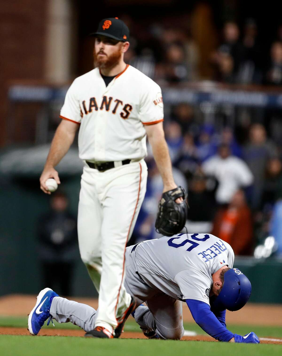 Los Angeles Dodgers' David Freese reacts after overrunning first base and being tagged out by San Francisco Giants' Sam Dyson in 7th inning during MLB game at Oracle Park in San Francisco, Calif., on Monday, April 29, 2019.