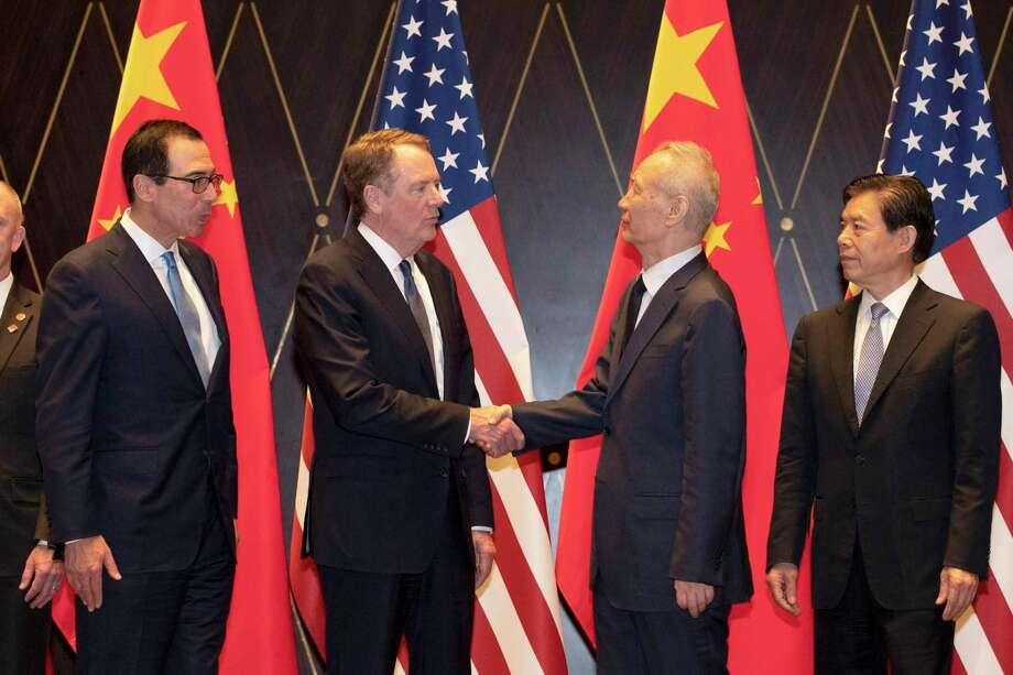 United States Trade Representative Robert Lighthizer, center left, shakes hands with Chinese Vice Premier Liu He as U.S. Treasury Secretary Steven Mnuchin looks on, left, with Chinese Commerce Minister Zhong Shan, right, after an official photo session at the Xijiao Conference Center in Shanghai on Wednesday, July 31, 2019. (AP Photo/Ng Han Guan, Pool) Photo: Ng Han Guan, STF / Associated Press / Copyright 2019 The Associated Press. All rights reserved.