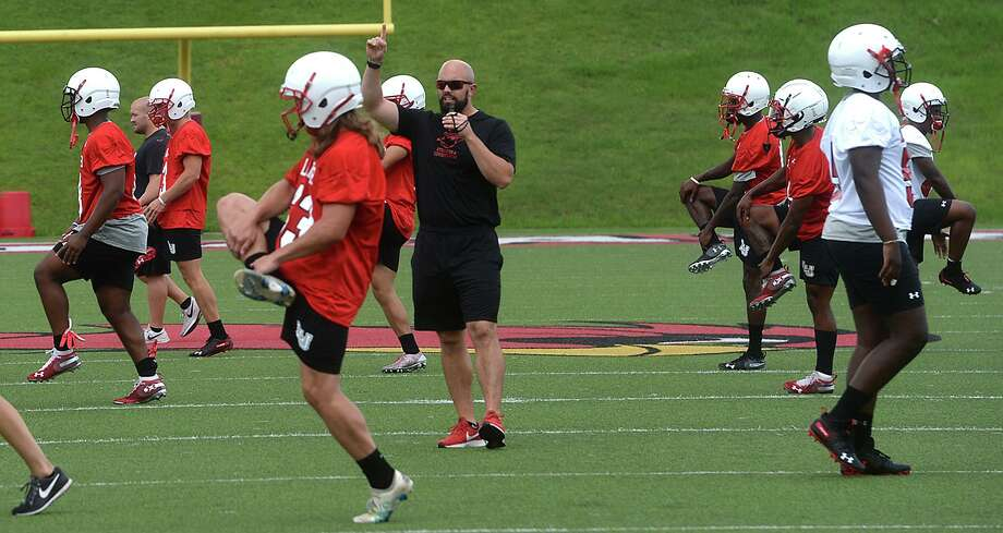 The Cardinals get in their first practice of training camp on the field at Provost Umphrey Stadium Wednesday.