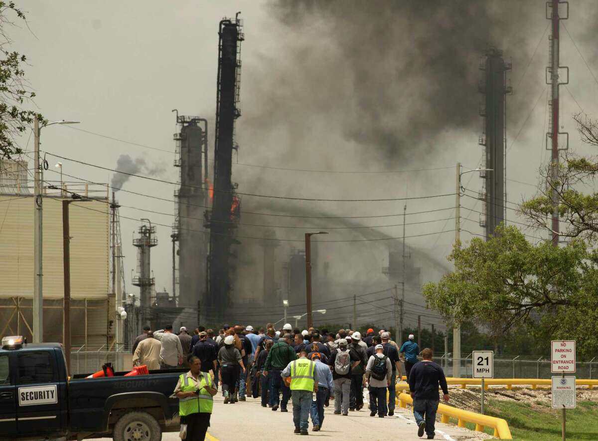 Evacuated ExxonMobil plant workers go back to the campus after the explosion fire is contained on Wednesday, July 31, 2019, in Baytown.