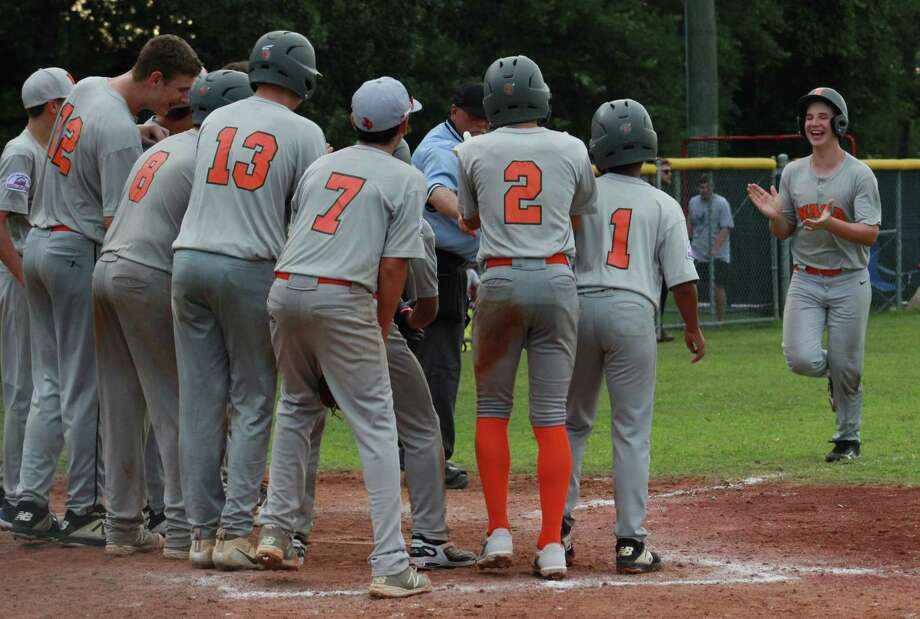 NASA-Orange players get ready to greet Riley Barr at home plate after  the incoming freshman at Clear Falls High smacked a game-ending homer at the Coast Region Tournament. Barr and Co. opened South Zone play in Louisiana Wednesday with an 18-7 win. Photo: Greg Beversdorf
