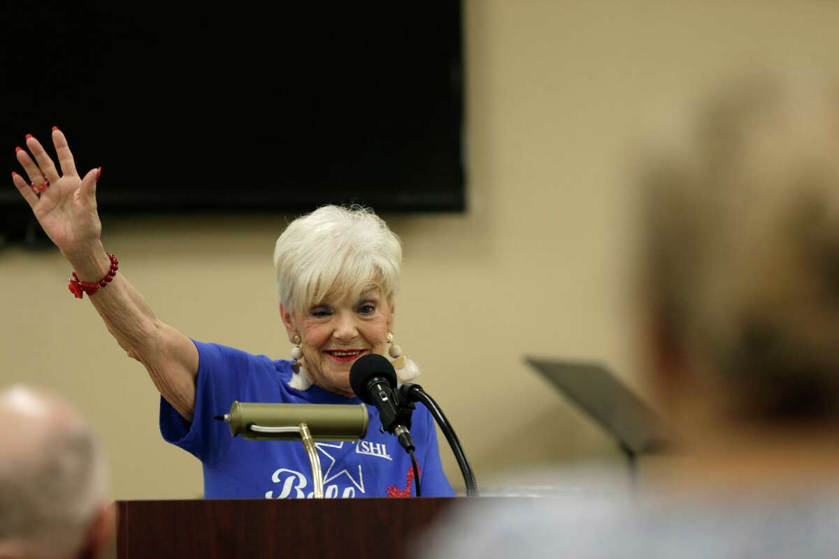 Doris Griffin, a senior advocate, waves as she speaks to seniors at Doris Griffin Senior Center on the Northwest Side on July 25. She and other members of the Texas Silver-Haired Legislature were gathering input from local residents about issues that need to be addressed at the state level.