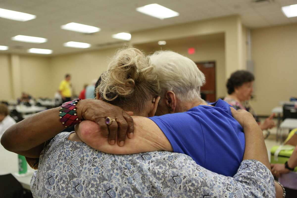 Doris Griffin embraces other women at the center named after her on July 25. Griffin, who is a lively advocate for seniors, is a frequent visitor at the Doris Griffin Senior Center.