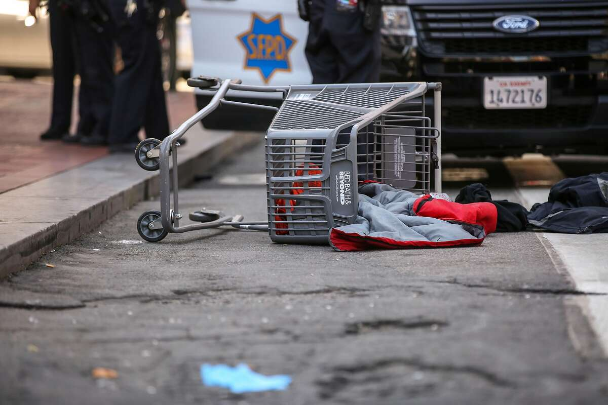 An overturned shopping cart near Market Street and 5th Street where a police officer allegedly shot a dog Wednesday, July 31, 2019, in San Francisco, Calif.
