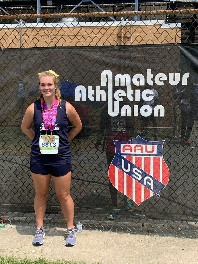 Midland Crusaders Track Club athlete Paige Low dons both her gold medals after winning the shot put and discus national titles at the AAU Junior Olympics in Greensboro, N.C. Photo courtesy Megan Spotts Photo: Megan Spotts