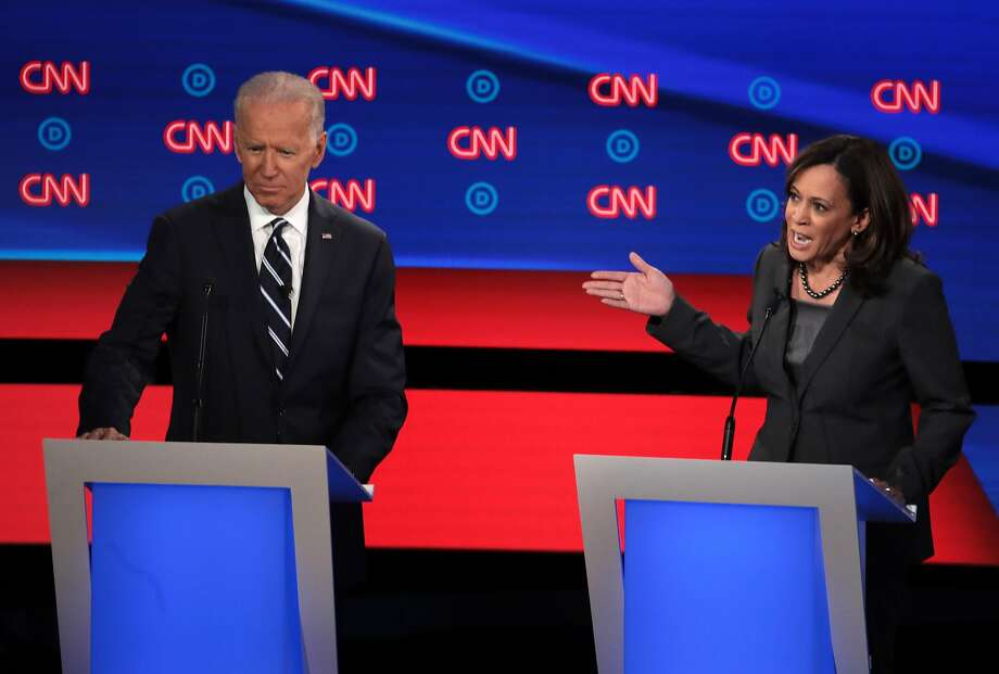 Democratic presidential candidate Sen. Kamala Harris (D-CA) (R) speaks while former Vice President Joe Biden listens during the Democratic Presidential Debate at the Fox Theatre July 31, 2019 in Detroit, Michigan. Photo: Scott Olson, Getty Images