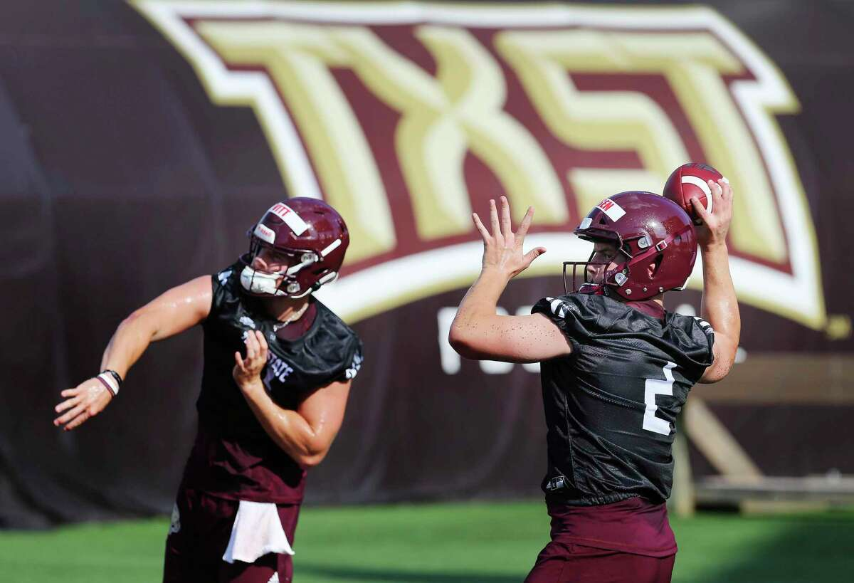 Quarterbacks Gresch Jensen (from right) and Tyler Vitt take part in passing drills as the Texas State Bobcats football team kicks off practice for their upcoming season under new head coach Jake Spavital. The team held practice at Bobcat Stadium on Wednesday, July 31, 2019. (Kin Man Hui/San Antonio Express-News)
