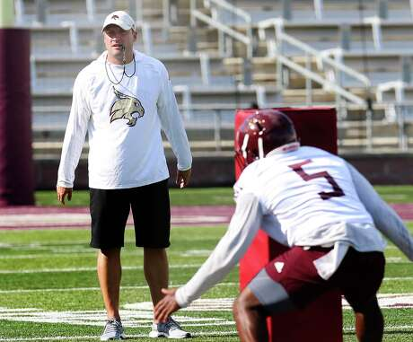 Newly hired Head Coach Jake Spavital oversees team drills as the Texas State Bobcats football team kicks off practice for their upcoming season. The team held practice at Bobcat Stadium on Wednesday, July 31, 2019. (Kin Man Hui/San Antonio Express-News)