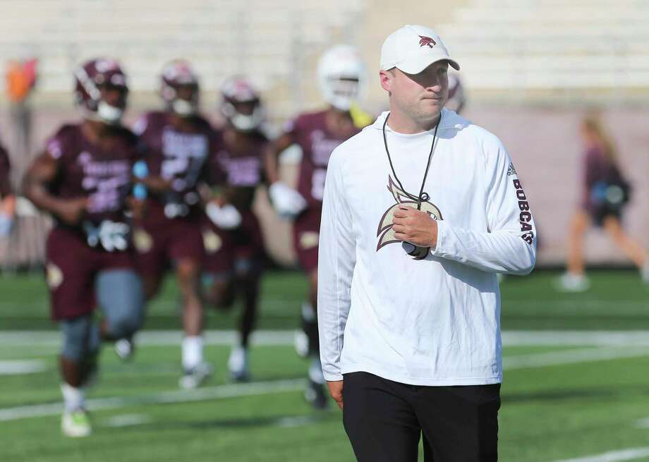 Newly hired Head Coach Jake Spavital oversees team drills as the Texas State Bobcats football team kicks off practice for their upcoming season. The team held practice at Bobcat Stadium on Wednesday, July 31, 2019. (Kin Man Hui/San Antonio Express-News) Photo: Kin Man Hui, Staff / Staff Photographer / ©2019 San Antonio Express-News
