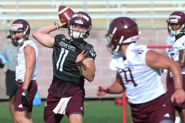 Quarterback Tyler Vitt (11) takes part in passing drills as the Texas State Bobcats football team kicks off practice for their upcoming season under new head coach Jake Spavital. The team held practice at Bobcat Stadium on Wednesday, July 31, 2019. (Kin Man Hui/San Antonio Express-News)