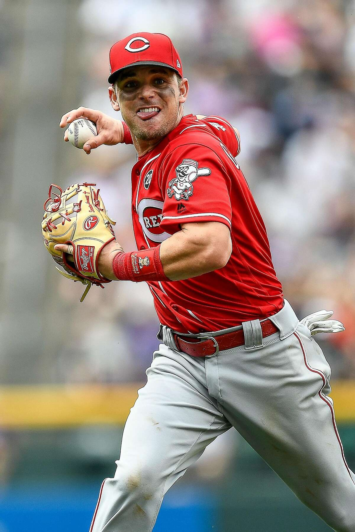 DENVER, CO - JULY 14: Scooter Gennett #3 of the Cincinnati Reds sets to throw after fielding a ground ball against the Colorado Rockies at Coors Field on July 14, 2019 in Denver, Colorado. ~~
