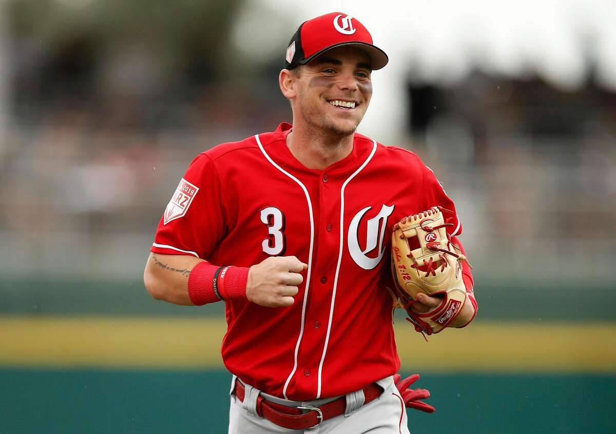 GOODYEAR, FL - MARCH 11: Scooter Gennett #3 of the Cincinnati Reds runs to the dugout during the Spring Training game against the Cleveland Indians at Goodyear Ballpark on March 11, 2019 in Goodyear, Arizona. ~~