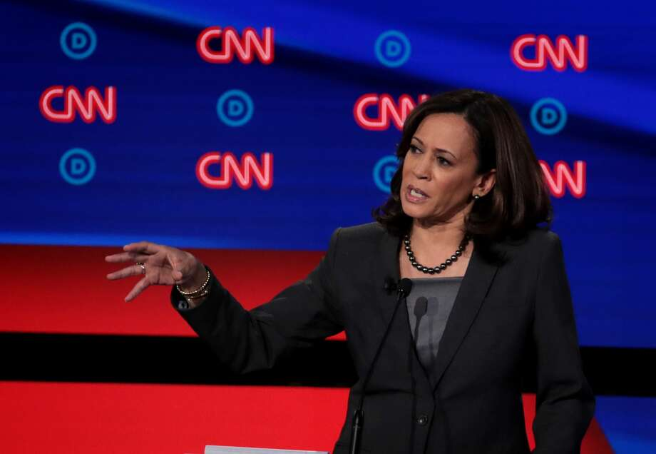 DETROIT, MICHIGAN - JULY 31:  Democratic presidential candidate Sen. Kamala Harris (D-CA) (R) speaks during the Democratic Presidential Debate at the Fox Theatre July 31, 2019 in Detroit, Michigan.  20 Democratic presidential candidates were split into two groups of 10 to take part in the debate sponsored by CNN held over two nights at Detroit's Fox Theatre.  (Photo by Scott Olson/Getty Images) Photo: Scott Olson/Getty Images