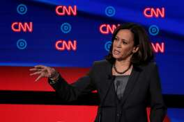 DETROIT, MICHIGAN - JULY 31: Democratic presidential candidate Sen. Kamala Harris (D-CA) (R) speaks during the Democratic Presidential Debate at the Fox Theatre July 31, 2019 in Detroit, Michigan. 20 Democratic presidential candidates were split into two groups of 10 to take part in the debate sponsored by CNN held over two nights at Detroit's Fox Theatre. (Photo by Scott Olson/Getty Images)