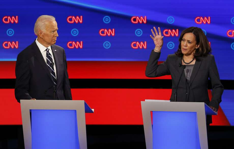 Sen. Kamala Harris, D-Calif., speaks as former Vice President Joe Biden listens during the second of two Democratic presidential primary debates hosted by CNN Wednesday, July 31, 2019, in the Fox Theatre in Detroit. (AP Photo/Paul Sancya) Photo: Paul Sancya, Associated Press