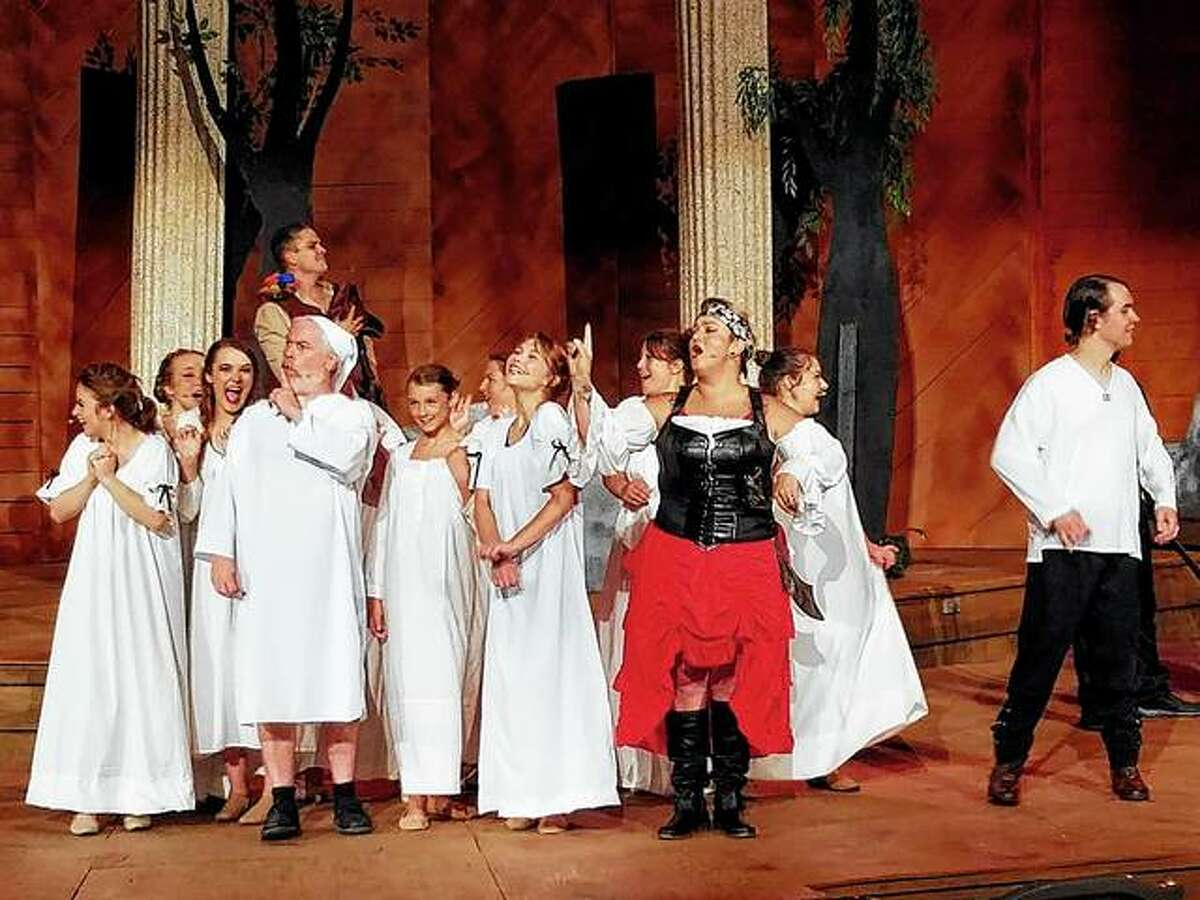 """Members of the cast of Gilbert and Sullivan's """"The Pirates of Penzance"""" rehearse a scene from the comic opera at Theatre in the Park at Lincoln's New Salem State Historic Site in Petersburg."""