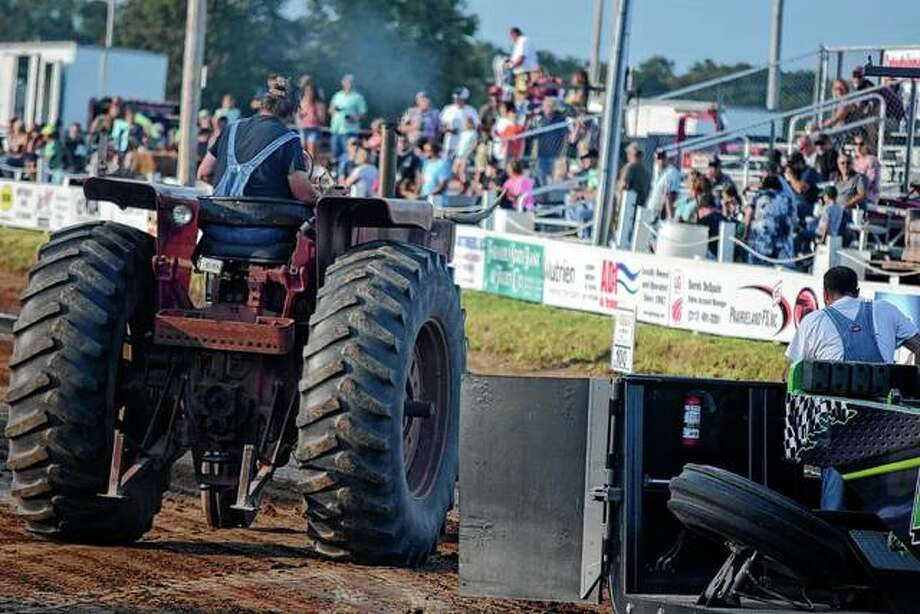 Tractor drivers prepare for the tractor pull Wednesday at the Brown County fairgrounds. Photo: Samantha McDaniel-Ogletree | Journal-Courier