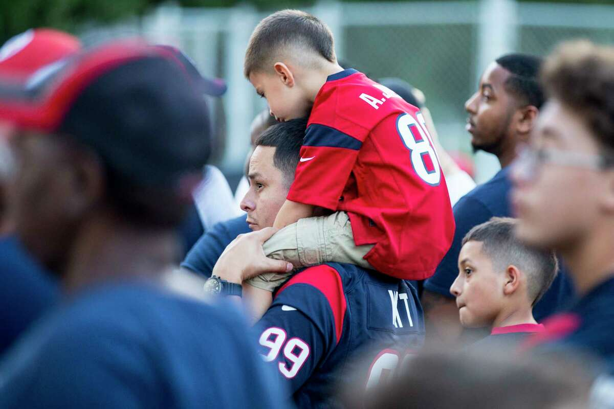 Houston Texans fans line up waiting for the gates to open to watch the Texans training camp practice at the Methodist Training Center on Thursday, Aug. 1, 2019, in Houston.