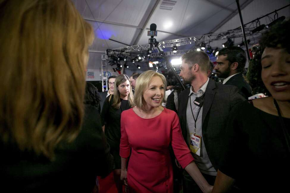 Senator Kirsten Gillibrand, a Democrat from New York and 2020 presidential candidate, walks through the crowd in the spin room following the Democratic presidential candidate debate in Detroit, Michigan, U.S., on Tuesday, July 30, 2019. The debate didn't produce the same stark contrasts between moderates and progressives as the forum Tuesday, which featured liberal firebrandsBernie SandersandElizabeth Warren. Photographer: Anthony Lanzilote/Bloomberg