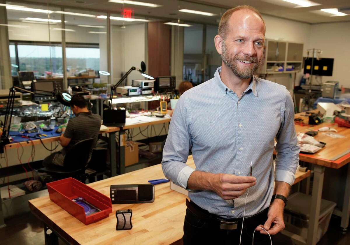 Jace Heuring, Procyrion chief scientific officer, holds part of the Aortix system Wednesday, July 31, 2019, in Houston. The Aortix would treat patients suffering from both heart failure and worsening kidney function. It has received the FDA's Breakthrough Device designation. The device is thinner than a pencil and is inserted using a catheter into the femoral artery located near a patient's groin. The Aortix is then moved upward to a position between the heart and kidneys in the aorta, which is the large artery that supplies blood to vital organs and the rest of the body.