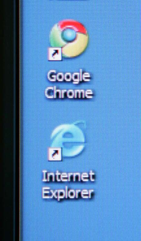 Google's Chrome browser shortcut is shown next to Microsoft's Internet Explorer browser shortcut during a news conference at Google Inc. headquarters in Mountain View, Calif., Tuesday, Spet. 2, 2008. Google Inc. is releasing its own Web browser, Chrome, in a long-anticipated move aimed at countering the dominance of Microsoft Corp.'s Internet Explorer and ensuring easy access to its market-leading search engine. (AP Photo/Paul Sakuma)