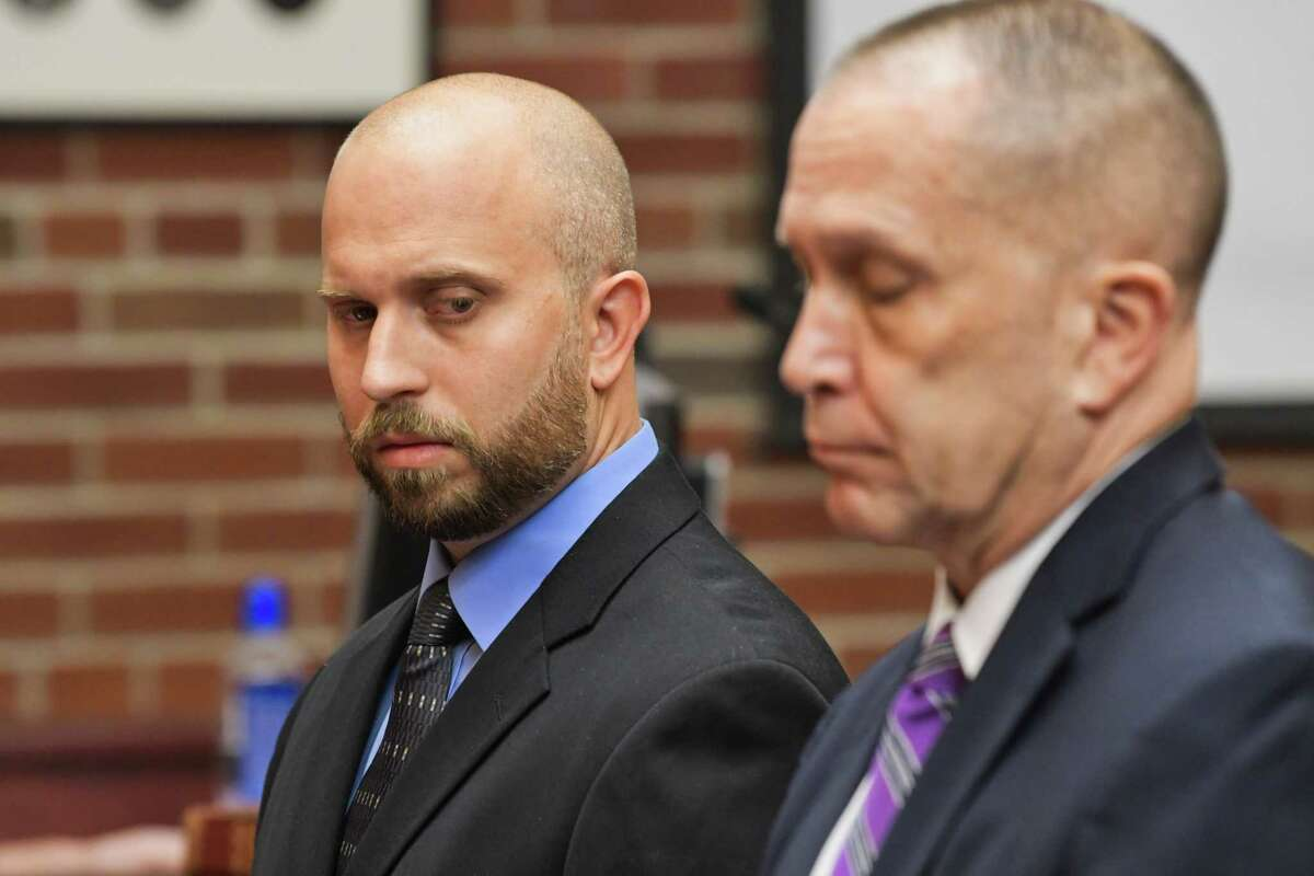 Lake George Central School District science teacher Eric Rosenbrock, left, appears for his arraignment with his attorney, David Taffany, at Saratoga County Court on Thursday, August 1, 2019, in Ballston Spa, N.Y. Rosenbrock, who was sentenced to five years probation, is back working at the high school.(Paul Buckowski/Times Union)
