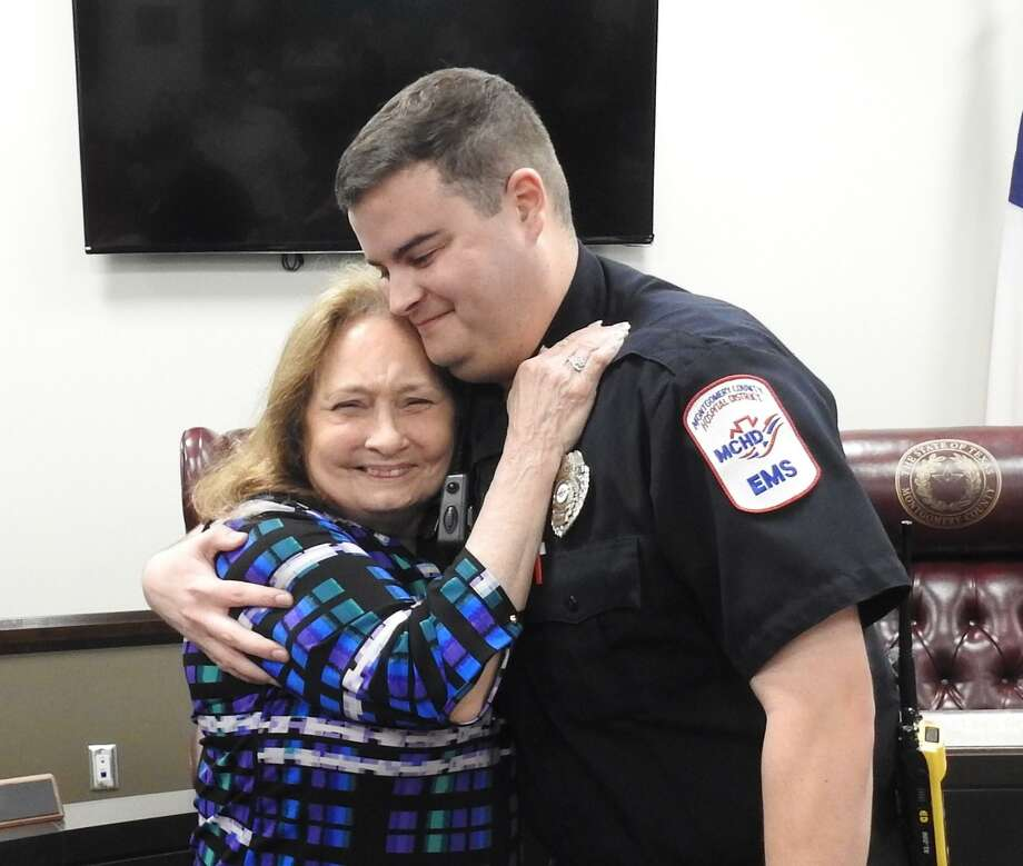 Spring resident Evelyn Huddleston hugs MCHD paramedic Spencer Lantz at a reunion withthe first responders who helped save her after she suffered a cardiac arrest recently. Photo: Courtesy Of The Montgomery County Hospital District