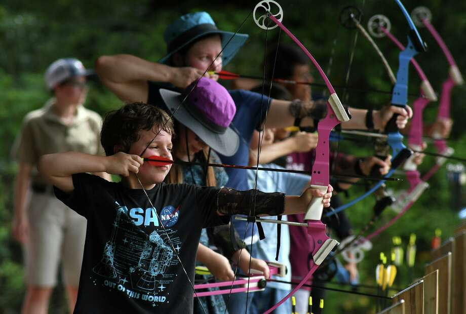 Alex Morgan, 7, from left, his sister Kat, 10, their mom Sarah, of Spring, and their fellow archers work on their bow and arrow technique during a Harris County Precinct 4 Trail As Parks program at Carter Park in Spring on July 30, 2019. Photo: Jerry Baker, Houston Chronicle / Contributor / Houston Chronicle