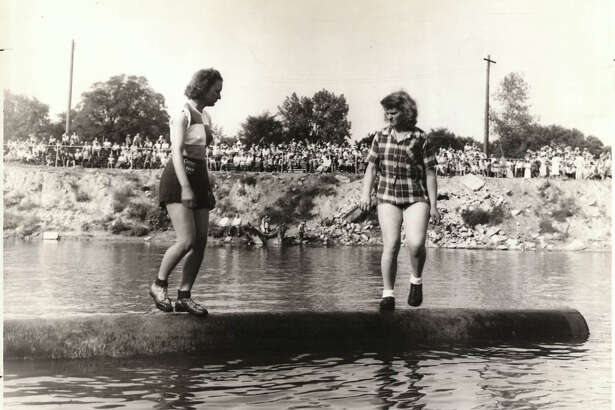 Finalists in the women's division of the birling tourney, were Mrs. Arbutus Lamoureaux, left, of Ladysmith, Wisconsin, and Virginia Hanson of Silver Lake, Washington. June 1953