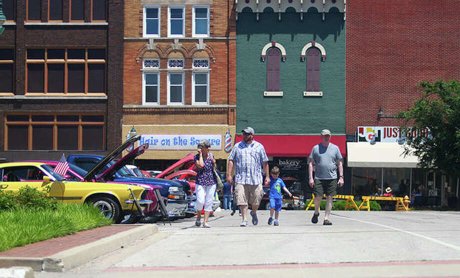 Visitors stroll through Jacksonville's square during the Downtown Plaza Car Show in June. Photo: Rosalind Essig | Journal-Courier